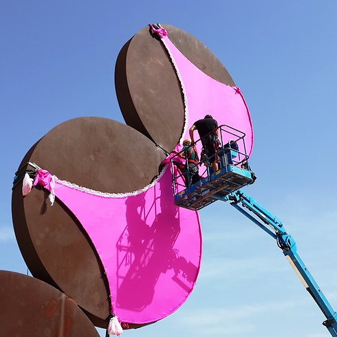 Putting a giant bra on one of Tel Aviv's most famous statues. (Photo: Amit Cotler)