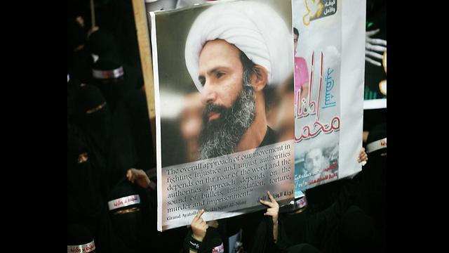 ארכיון. המחאה נגד הוצאתו להורג של השייח (צילום: AP) (צילום: AP)