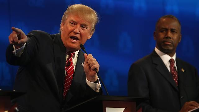קרסון (מימין) פרש מהמרוץ הרפובליקני לנשיאות ותמך במועמדותו של טראמפ (צילום: AFP) (צילום: AFP)