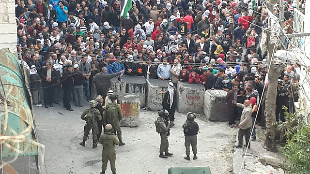 Wednesday in Hebron: Local leadership standing in between the masses and the soldiers.