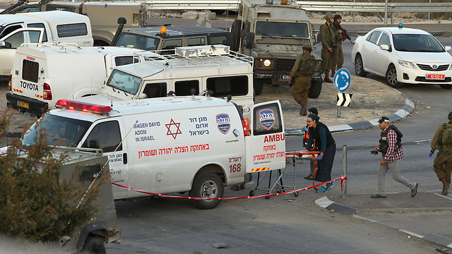 Evacuating the wounded after a recent West Bank terror attack (Photo: AFP)