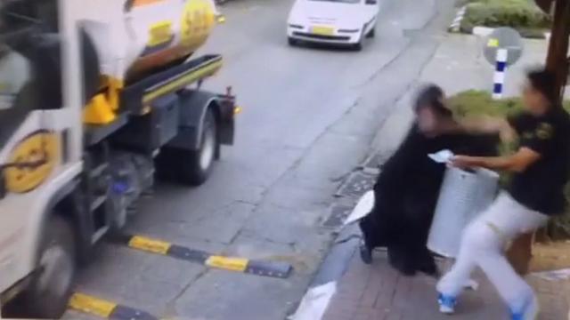 Still from video of the attack in Beitar Illit