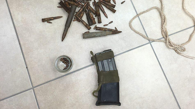 Gun magazine and bullets found at the home of a youth suspected of attacking Rabbi Arik Ascherman (Photo: Police Spokesperson's Department)