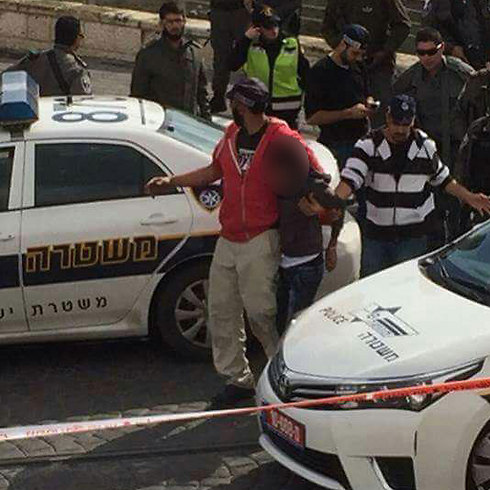 One of the attackers being arrested at Pisgat Ze'ev