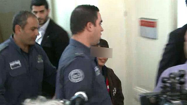 Muawiya Alqam, who carried out a stabbing on Jerusalem's light rail, in custody. (Photo: Ofer Meir)