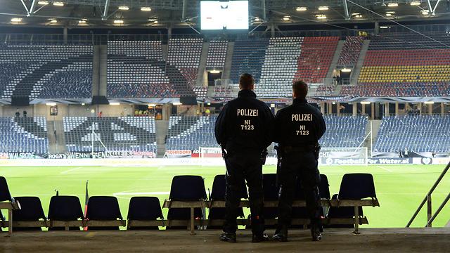 The evacuated stadium in Hanover, Germany. (Photo: EPA)