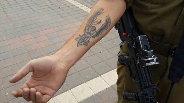 Ziyad's first tattoo, featuring a Magen David. (Photo: Yoav Zitun)
