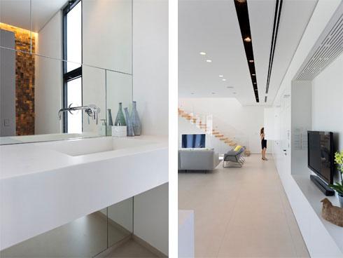מימין: מבט מכיוון שירותי האורחים. בפנים (משמאל) קיר מראות וקיר שצופה באבן (צילום: שי אפשטיין)