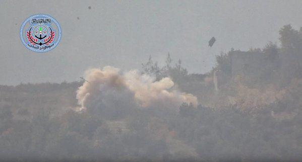 Screenshot from a video claiming to show a Russian helicopter being blown up by a Free Syrian Army fighter.