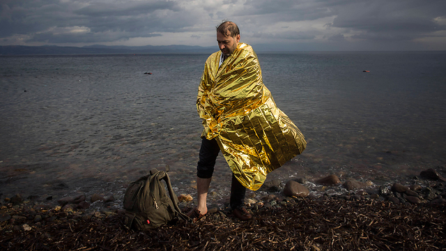 A refugee on the shore of the Greek island of Lesbos. (Photo: AP)