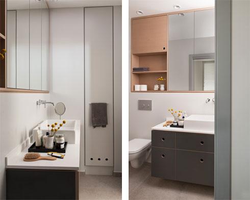 חדר הרחצה של ההורים. הארון הצר שבתמונה השמאלית משמש לאחסון מגבות, וצידו השני שבמסדרון משמש לאחסון כלי ניקוי וכלי עבודה (צילום: גלית דויטש)