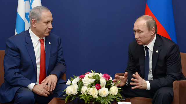 Netanyahu and Putin in their last meeting in Paris (Photo: Amos Ben Gershom, GPO)