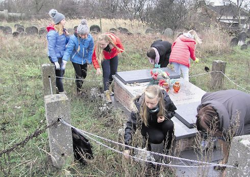 Polish students tending to the Jewish cemetery in Radomsko