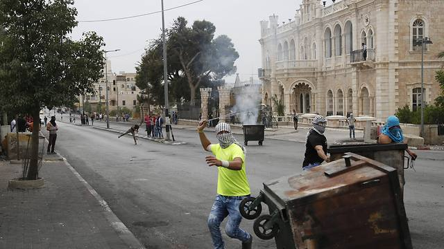 Rioting outside the Jacir Palace hotel in Bethlehem (Photo: AP)