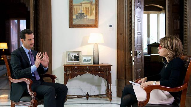 Assad speaking to journalist Hala Jaber of the Sunday Times (Photo: EPA)