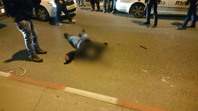 The attacker, killed by police.