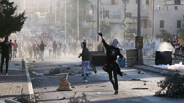 Palestinian youth taking part in clashes in Bethlehem. Palestinian authorities have been telling children to go and throw stones in demonstrations rather than going out and getting killed after committing a terror attack (Photo: AFP)
