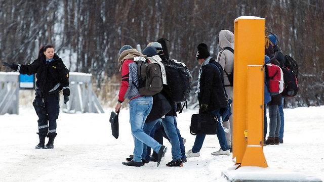 """""""אם אתה רוצה להיות חלק מאיתנו, אתה צריך להבין מהם הערכים שלנו"""". פליטים שנכנסו לנורבגיה (צילום: AFP )"""