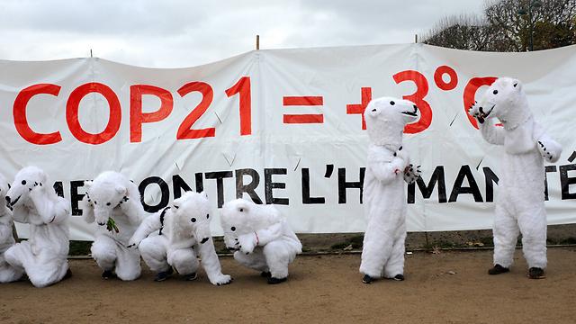 כדור הארץ בסכנה. הפגנה בפריז  (צילום: MCT) (צילום: MCT)