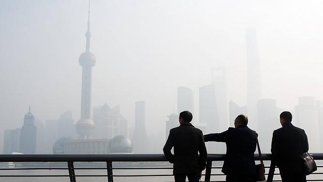 זיהום אוויר בעיר שנגחאי בסין (צילום: AFP) (צילום: AFP)