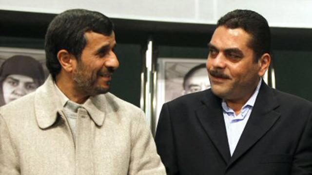 עם נשיא איראן לשעבר מחמוד אחמדינג'אד (צילום: AFP) (צילום: AFP)