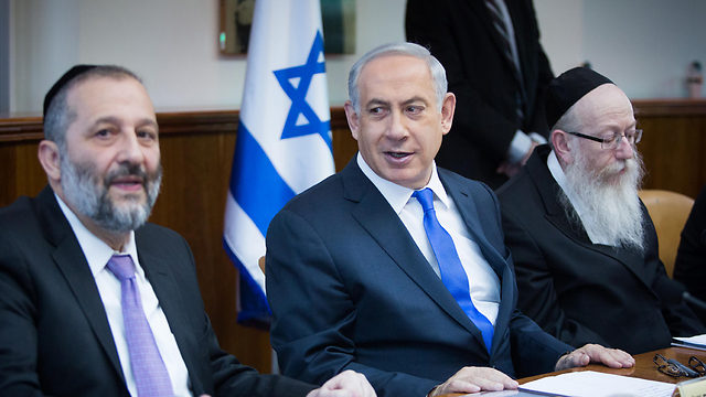 Netanyahu (center) with Haredi Ministers Aryeh Deri (L) and Yakov Litzman. A long series of capitulations to the ultra-Orthodox sector (Photo: Yonatan Sindel/Flash 90) (Photo: Yonatan Sindel/Flash90)