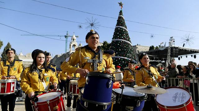 Christmas parade in Bethlehem (Photo: Reuters)