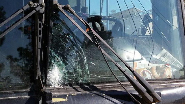 The shattered windshield of one of the buses (Photo: Hatzalah)