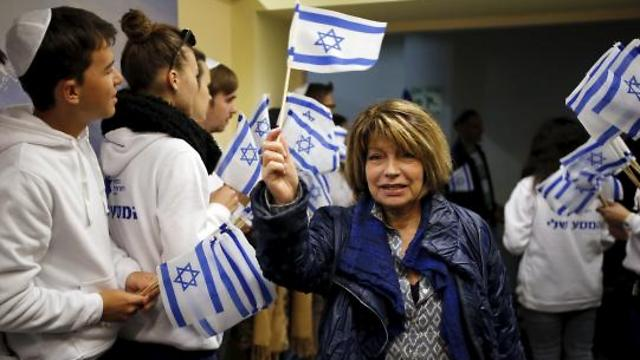A Jewish immigrant from France arrives for a candle-lighting ceremony to mark Hanukkah, upon landing at Ben Gurion International Airport (Photo: Reuters)