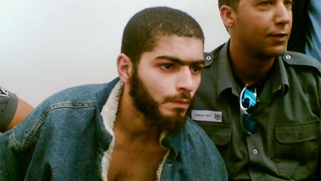 The suspect in the Tel Aviv shooting during a previous arrest (Photo: Raanan Ben Zur)