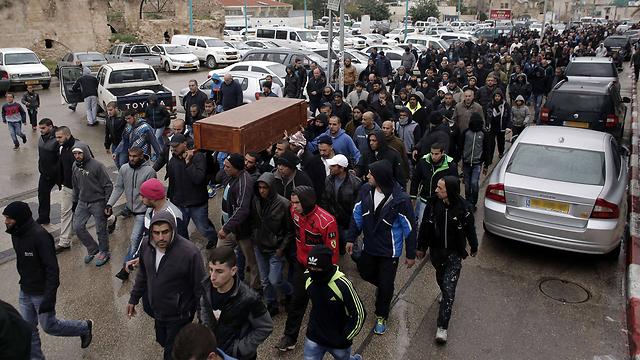 הלווייתו של אמין שעבאן, היום בלוד (צילום: AFP) (צילום: AFP)
