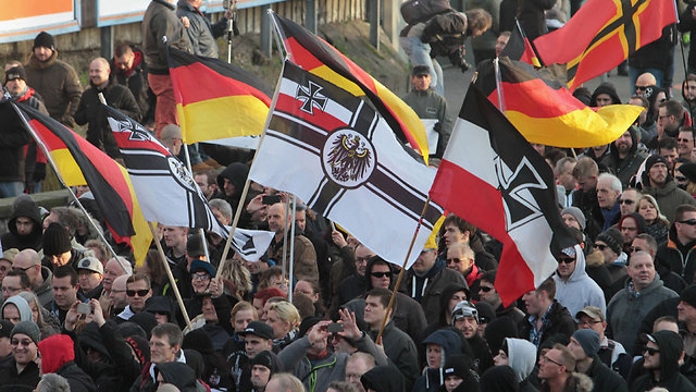 Protester waves pre-WWI German Empire flag during anti-Islam demonstration in Germany (Photo: AP)