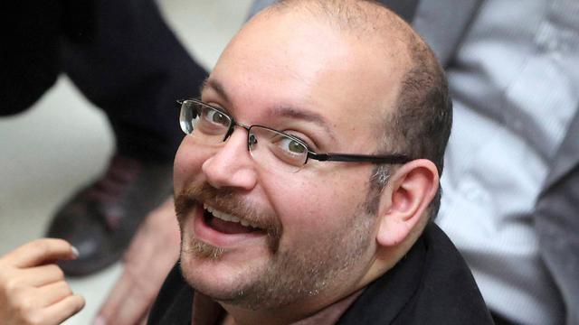 """עיתונאי ה""""וושינגטון פוסט"""" ג'ייסון רזאיאן (צילום: AP) (צילום: AP)"""