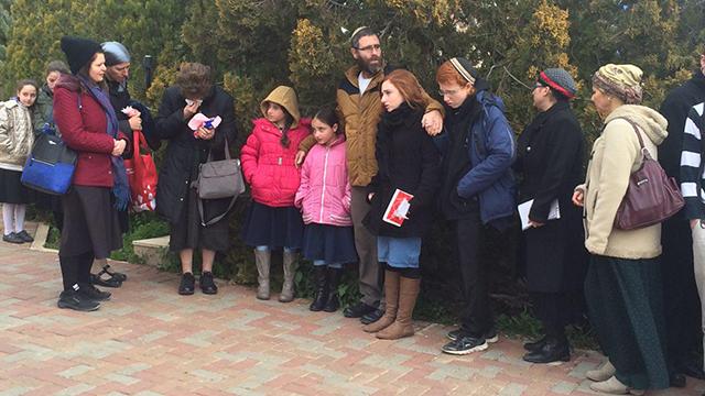 Family and friends gather in Otniel (Photo: Elisha Ben Kimon)