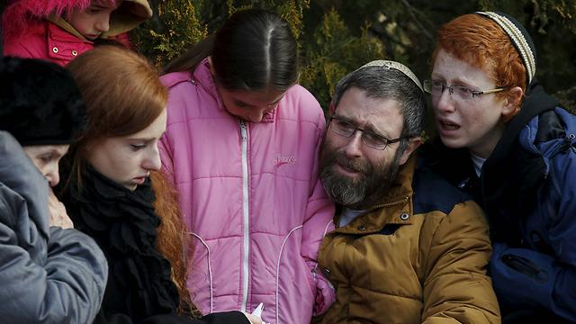Natan Meir, Dafna's widower, with their children (Photo: Reuters)
