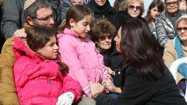 Culture Minister Miri Regev comforting Dafna's husband and children (Photo: TPS)