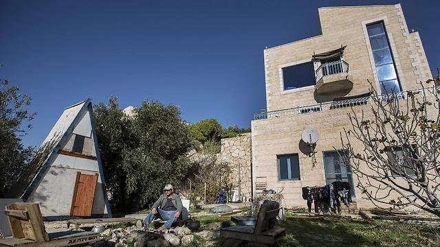Moshe Gordon in front of his guesthouse in the West Bank (Photo: AP)