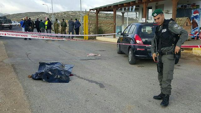 The would-be attacker after she was shot dead at the scene of the attempted stabbing (Photo: Police)