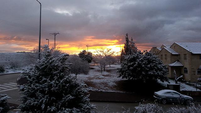 A snow-covered Ofra at sunrise (Photo: Shachar Stanislavski)