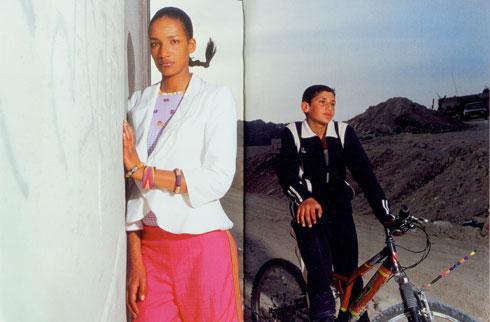 קמפיין ''נשים חוצות גבולות'' על רקע גדר ההפרדה (באדיבות קום איל פו)