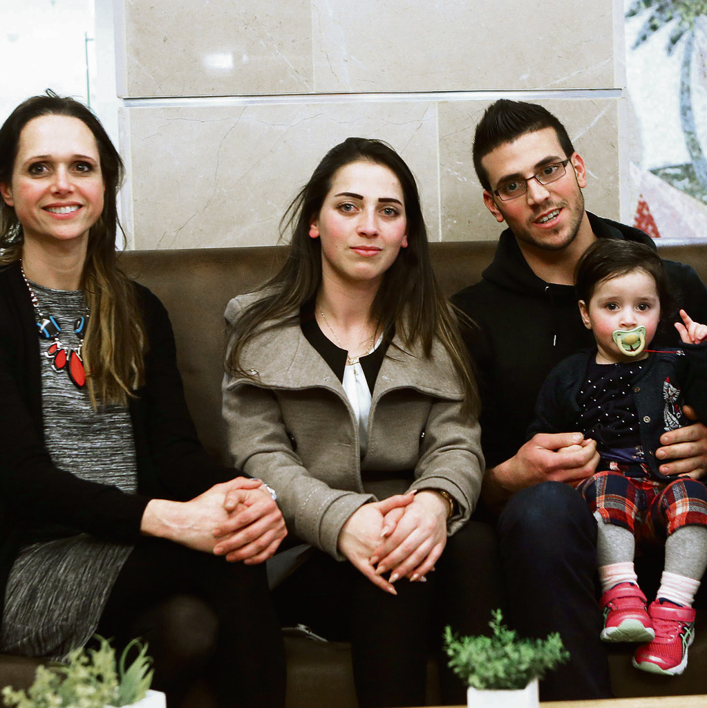 Rinal Seif (center) with younger brother Kinan and her baby. At left: Shabbat host Tova