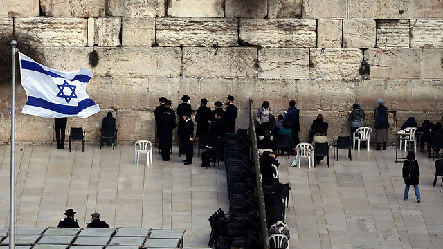 People in prayer at the Western Wall (Photo: AFP)