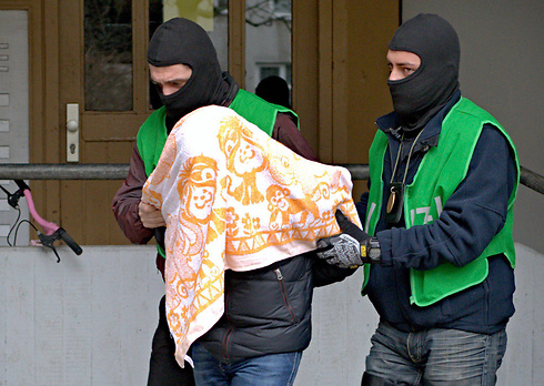 One of the arrested suspects, in Berlin. (Photo: EPA)