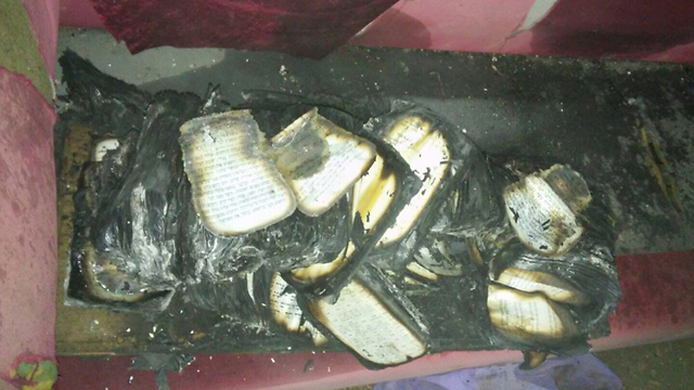 Burnt books, which residents say appear to have been put in a pile (Photo: Karmei Tzur Security)