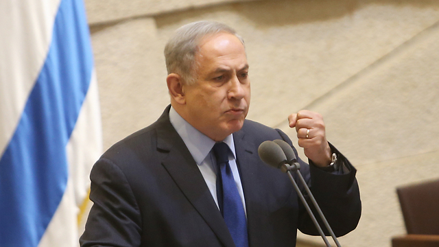 Netanyahu speaking at the Knesset (Photo: Alex Kolomoisky)