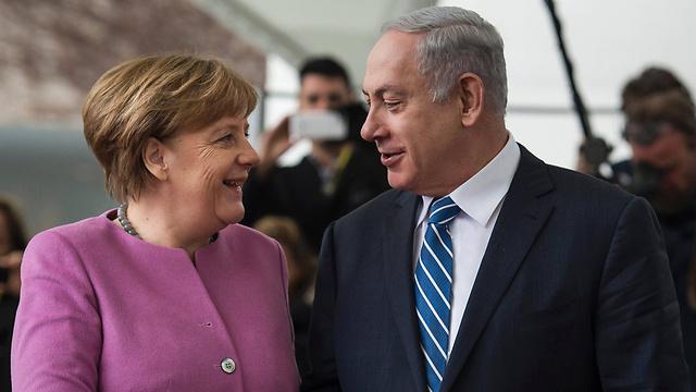 Merkel and Netanyahu meet in Berlin (Photo: AFP)