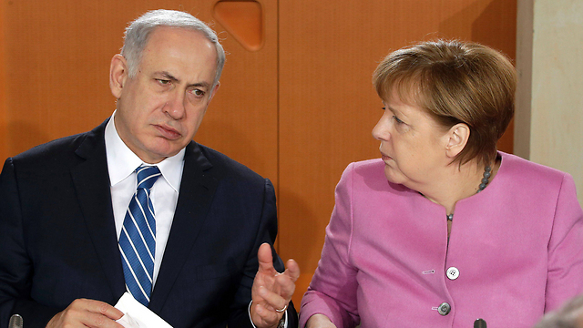 Netanyahu and Merkel meet in Berlin (File photo: AFP)