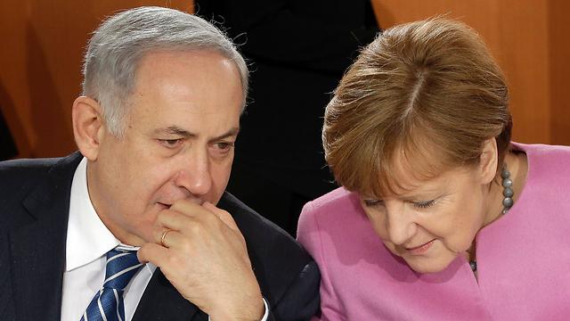 Netanyahu and Merkel meet in Berlin (Photo: AFP) (Photo: AFP)