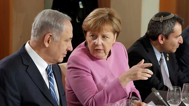 Netanyahu and Merkel in Berlin during last year's G2G meeting (Photo: Reuters)