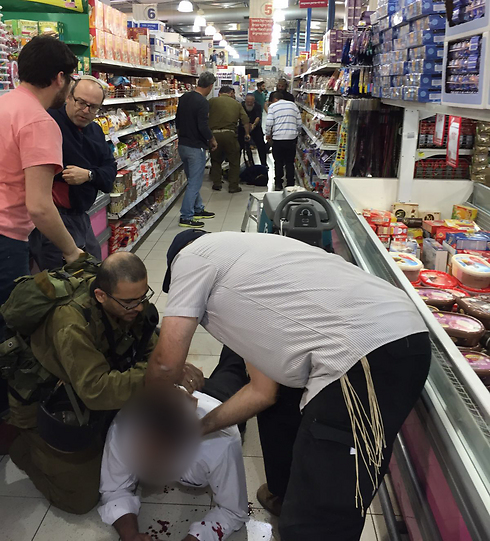 One of the wounded being treated at the scene of the attack (Photo: Uziel Vatik)